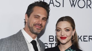 """In this March 1, 2017, file photo, actor Thomas Sadoski (L) and actress Amanda Seyfried arrive at the premiere of Bleecker Street Media's """"The Last Word"""" at ArcLight Hollywood in Hollywood, California."""