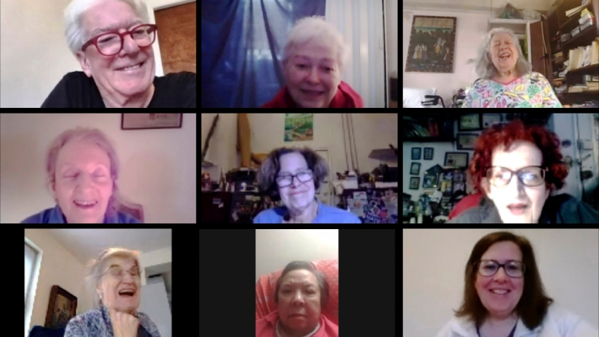 In this May 11, 2020, image made from video provided by Greenwich House, people laugh as they gather online for a comedy class through Greenwich House in New York. Professional comedian Jo Firestone leads the group through monologue bits and rapid-fire prompts as they try to find humor during the coronavirus pandemic.