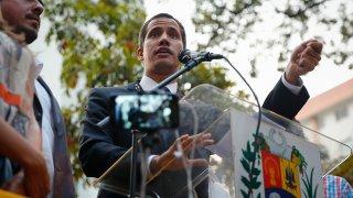 Venezuela's Juan Guaido speaks from a lectern