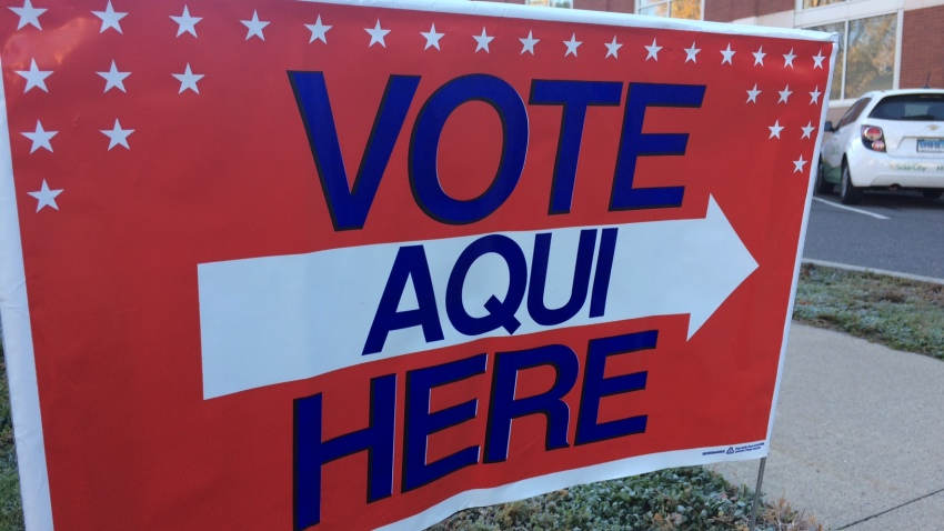A sign outside a Hartford polling location has signs in English and Spanish.