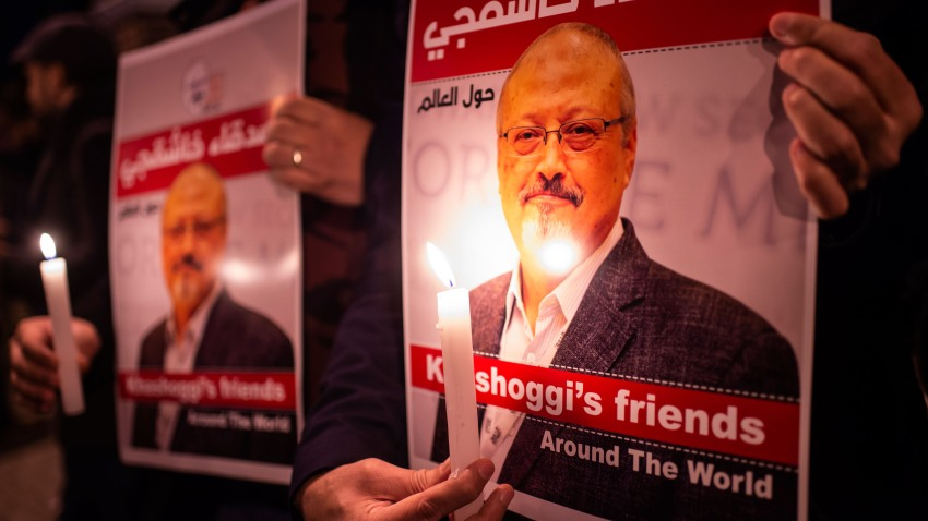 In this file photo, people hold posters picturing Saudi journalist Jamal Khashoggi and lightened candles during a gathering outside the Saudi Arabia consulate in Istanbul, on October 25, 2018.