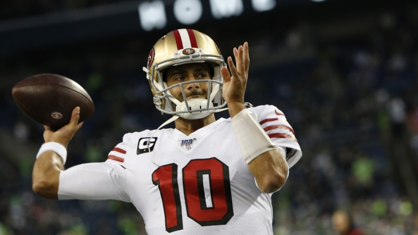 Jimmy Garoppolo of the San Francisco 49ers passes on the field