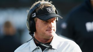 Jon Gruden looks on as the Oakland Raiders play the Tennessee Titans.