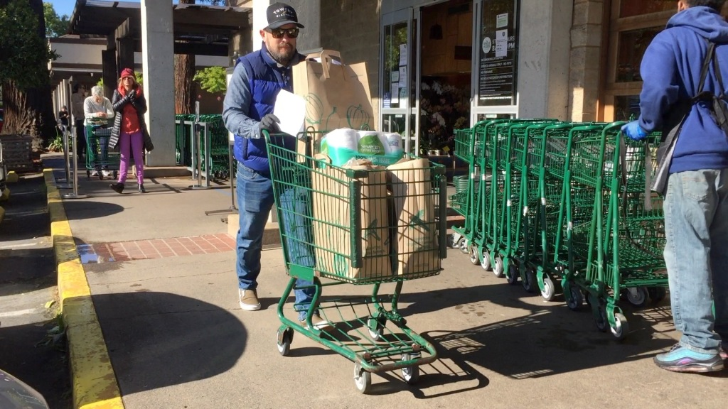 Electrician Kevin Johnson shops for groceries at Whole Foods in Mill Valley to deliver to a nearby senior.