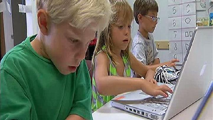 Kids-using-laptops
