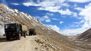 In this Aug. 5, 2012, file photo, an Indian army convoy moves towards the border in Pangong, a disputed territory between India and China, in Ladakh, Indian-administered Kashmir.