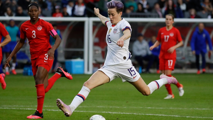 In this Feb. 9, 2020, file photo, U.S. forward Megan Rapinoe scores against Canada during the second half of a CONCACAF women's Olympic qualifying soccer match in Carson, Calif.
