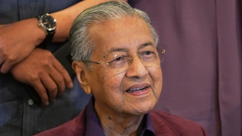 In this Feb. 22, 2020, file photo, Malaysian Prime Minister Mahathir Mohamad, speaks during a press conference in Putrajaya, Malaysia. Malaysia's alliance government under 94-year-old Prime Minister Mahathir is threatening to unravel less than two years after a historic election victory ousting the coalition that had ruled the country since independence.