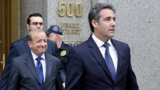 In this May 30, 2018, file photo, President Donald Trump's personal attorney Michael Cohen, right, leaves Federal Court, in New York.