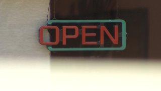 business neon open sign unlit