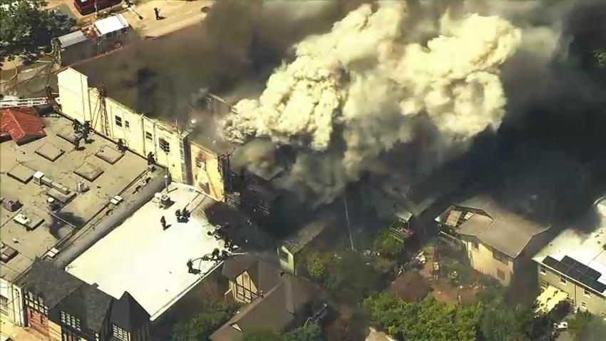 Firefighters battle a blaze in Oakland.