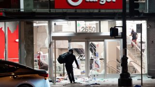 A looter robs a Target store.