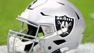 Detailed view of a Raiders helmet.