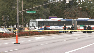 Officials in Redwood City work at the scene of a deadly collision involving a pedestrian and a SamTrans bus.