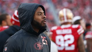 Richard Sherman of the San Francisco 49ers looks on from the sideline.