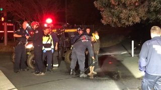 Crews rescue a cold and muddy driver in San Jose.