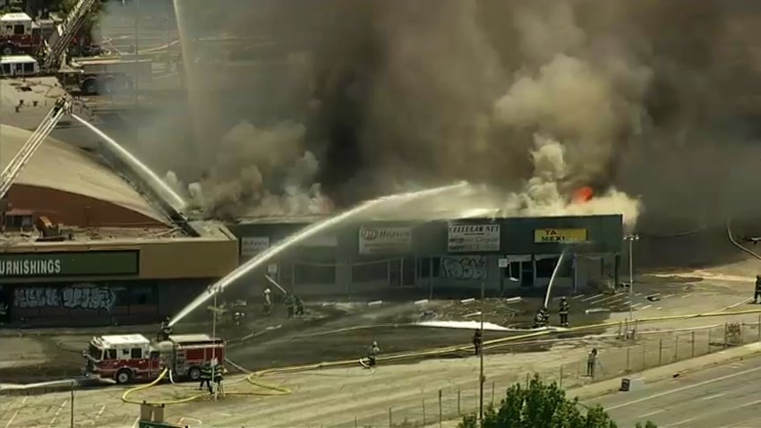 Firefighters battle a blaze at a strip mall in San Jose.