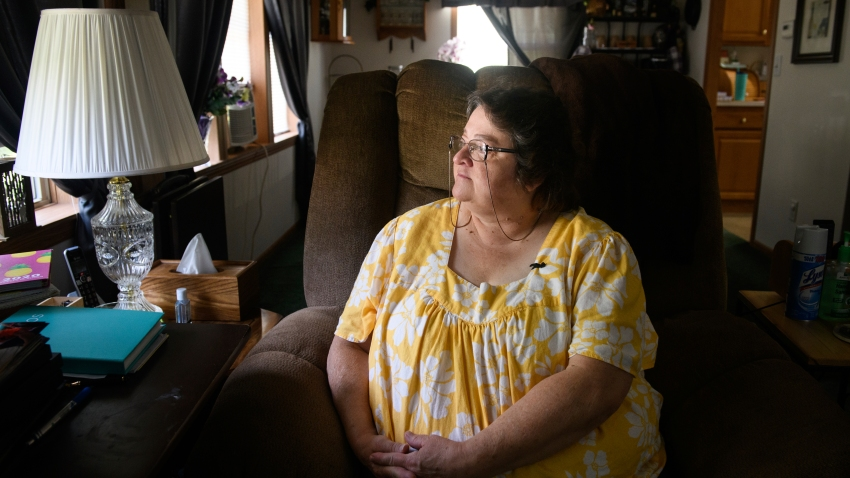 In this June 29, 2020, file photo, Doris Kelly, 57, sits in her home in Ruffs Dale, Pa. Kelly was one of the first patients in a UPMC trial for COVID-19.