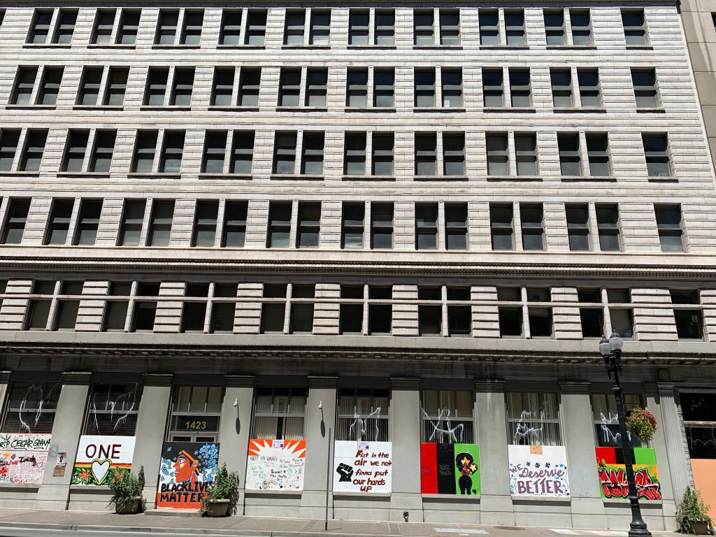 Buildings along Broadway in downtown Oakland are covered in murals reflecting the Black Lives Matter movement and the death of George Floyd.