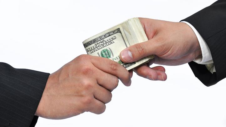 generic bribe generic bribery businessmen exchange cash