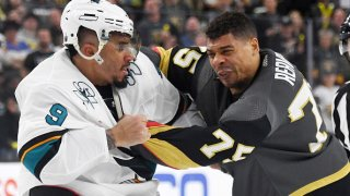 Evander Kane #9 of the San Jose Sharks and Ryan Reaves #75 of the Vegas Golden Knights