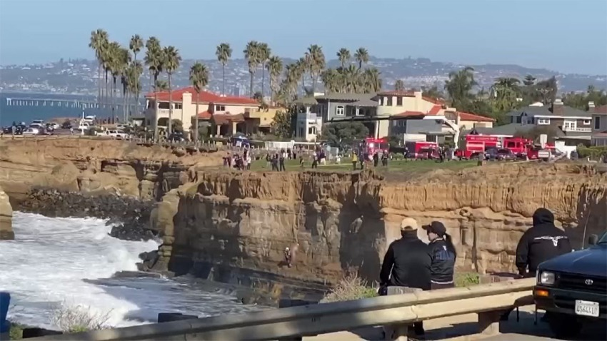 man on cliff blurred