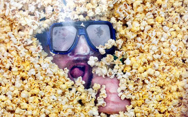 Man Swims in Popcorn