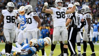 Raiders player Maxx Crosby posing after a sack