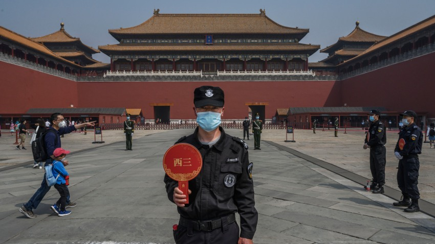 In this May 1, 2020, file photo, a Chinese guard wears a protective mask as he stands at the entrance to the Forbidden City as it re-opened to limited visitors or the May holiday in Beijing, China.