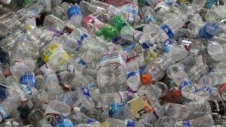 Hundreds of plastic bottles in a pile.