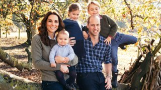 This file photo released by Kensington Palace on Friday Dec. 14, 2018, shows the photo taken by Matt Porteous of Britain's Prince William and Kate, Duchess of Cambridge with their children Prince George, right, Princess Charlotte, center, and Prince Louis at Anmer Hall in Norfolk, east England, which is to be used as their 2018 Christmas card.