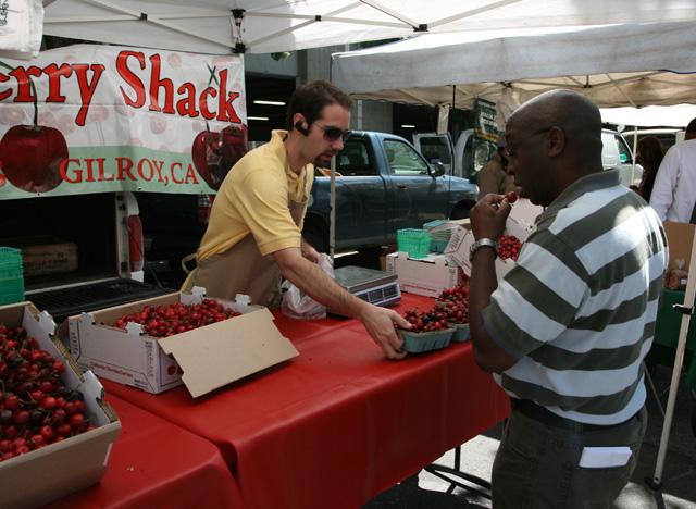 sj farmers market - cherry guy with man tasting aspect web