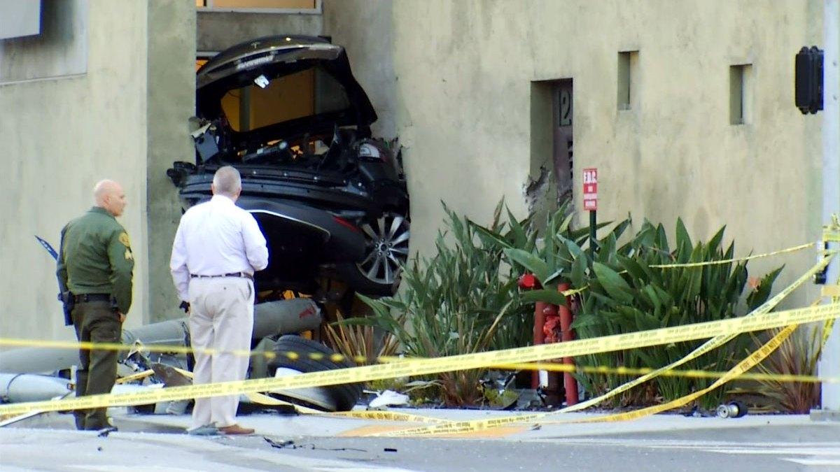 Officers Injured, Stolen Tesla Split in Half After Fiery ...