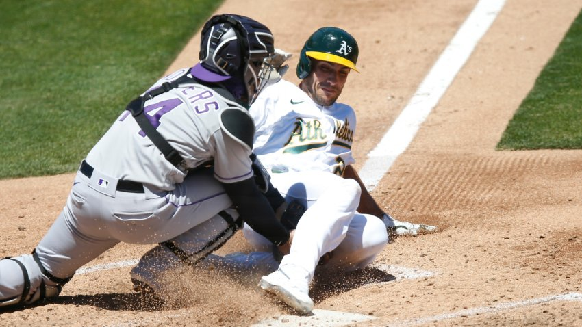 Matt Olson #28 of the Oakland Athletics is tagged out.