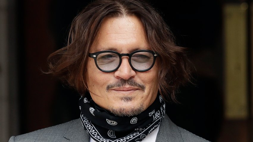 In this July, 13, 2020, file photo, American actor Johnny Depp poses for the media as he arrives at the High Court in London.