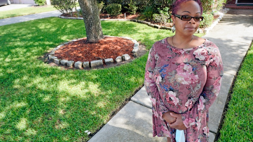 "Parent and teacher Stacey Pugh poses for a photograph outside her home Monday, July 13, 2020, in Humble, Texas. While children have proven to be less susceptible to the coronavirus, teachers are vulnerable. ""I will be wearing a mask, a face shield, possibly gloves, and I'm even considering getting some type of body covering to wear,"" says Pugh, a fifth-grade teacher in suburban Houston."