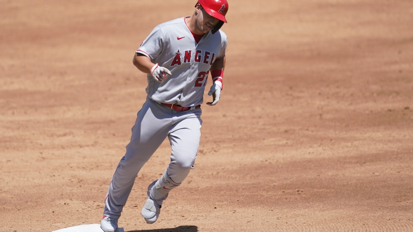 Los Angeles Angels' Mike Trout rounds the bases after hitting a three-run home run against the Oakland Athletics during the third inning of a baseball game in Oakland, Calif., Sunday, July 26, 2020.