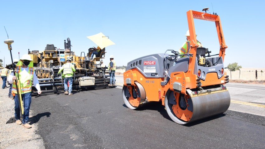 Crews repave a stretch of highway in Northern California with a mixture that includes single-use plastic bottles.