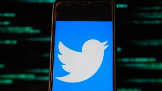 In this photo illustration, a Twitter logo is seen displayed on a smartphone.