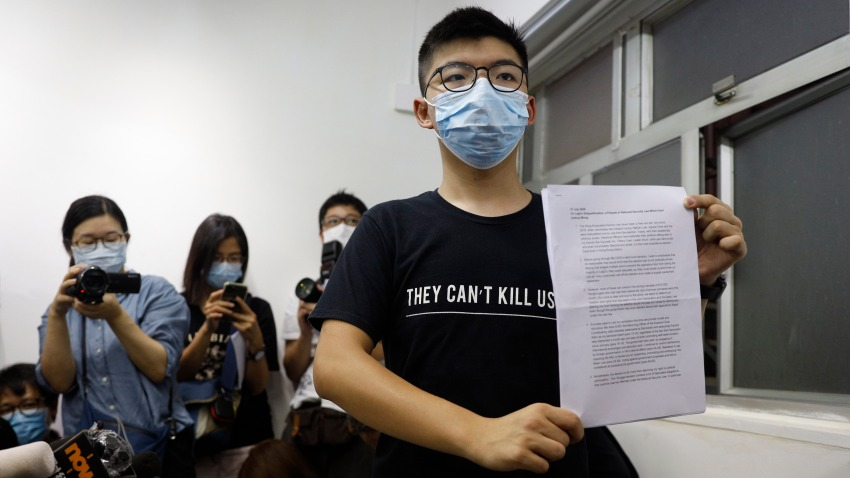 Hong Kong pro-democracy activist Joshua Wong shows his disqualification notice during a press conference in Hong Kong, Friday, July 31, 2020. On Thursday, 12 pro-democracy candidates including prominent pro-democracy activist Joshua Wong were disqualified from running in the legislative elections, as they were deemed to not comply with the Basic Law or pledge allegiance to the city and Beijing.