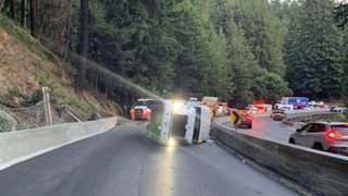 An overturned big-rig shut down southbound Highway 17
