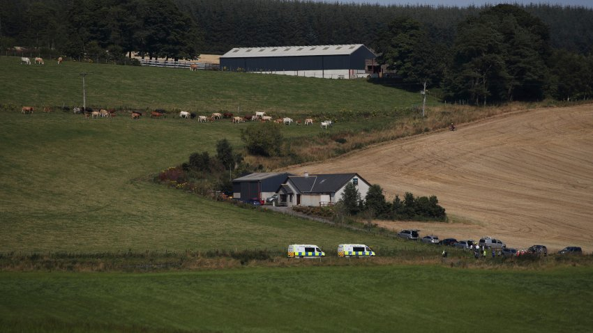 Emergency services in Stonehaven, Scotland, near the scene where a train derailed. Police and paramedics were responding Wednesday to a train derailment in northeast Scotland, where smoke could be seen rising from the site. Officials said there were reports of serious injuries. The hilly area was hit by storms and flash flooding overnight.