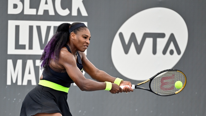 Serena Williams returns a shot to her sister Venus Williams during the WTA tennis tournament