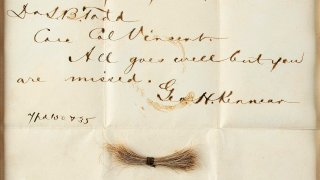 a bloodstained telegram and lock of hair from former President Abraham Lincoln