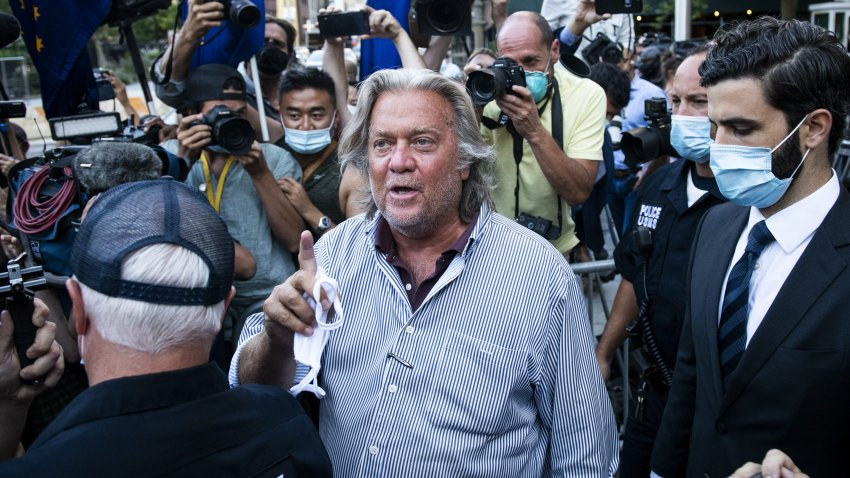 In this Aug. 20, 2020, file photo, Steve Bannon, former U.S. President Donald Trump political strategist, center, departs from federal court in New York.