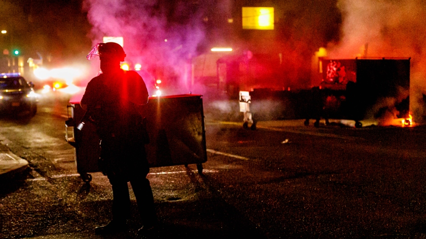 About two hundred persons protesting police brutality spray graffiti and start fires at the Portland Police Union building, in Portland, Oregon, United States on August 28, 2020, the 93rd day of consecutive protests.