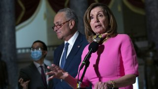 Senate Minority Leader Chuck Schumer, center, listens as House Speaker Nancy Pelosi speaks to members of the media following a meeting at the U.S. Capitol in Washington, D.C., Aug. 7, 2020.