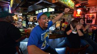 A sports fan inside Ricky's Sports Theatre & Grill in San Leandro.