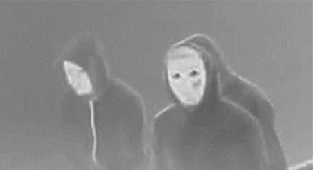 A photo of the suspects who fled the area after they appeared to deliberately set a house fire in Denver, killing 5.