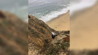 A photo taken by firefighters at the scene of a vehicle crash over the cliff off of Highway 1 near Gray Whale Cove south of Devil's Slide in San Mateo County, California on Aug. 31, 2020.